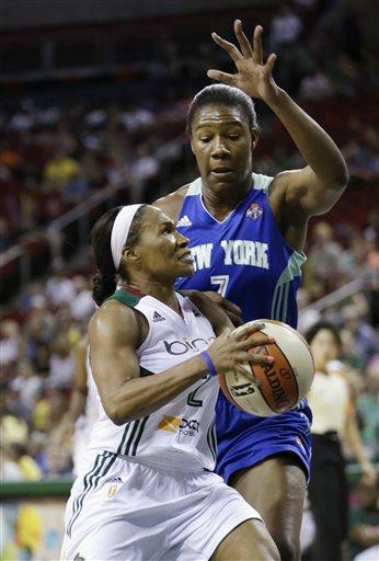 Seattle Storm's Temeka Johnson, left, tries to drive against New York Liberty's Avery Warley in the first half of a WNBA basketball game Friday, June 28, 2013, in Seattle. (AP Photo/Elaine Thompson)