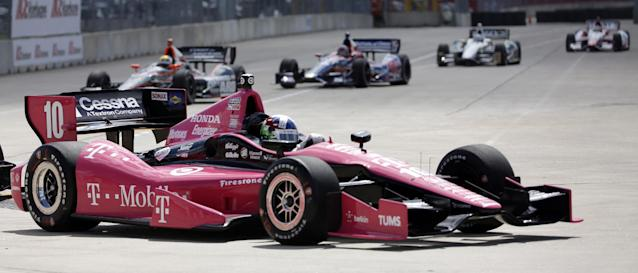 Dario Franchitti, of Scottland, races during practice for the IndyCar Grand Prix of Houston auto race, Friday, Oct. 4, 2013, in Houston. Practice was delayed due to surface issues in turn one. (AP Photo/David J. Phillip)