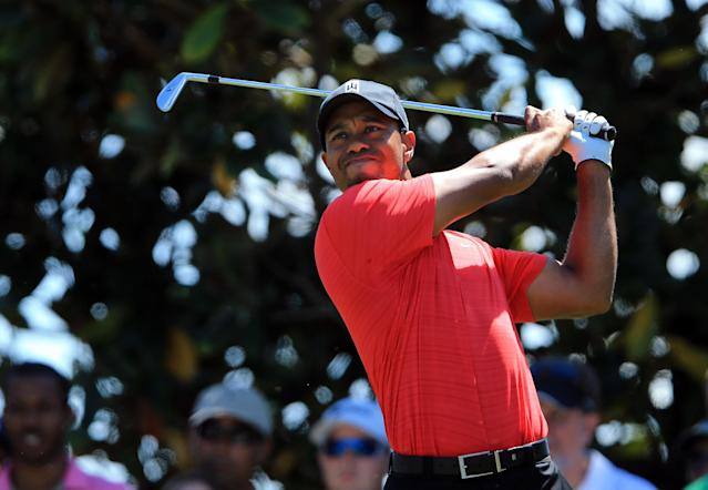 ORLANDO, FL - MARCH 25: Tiger Woods of the USA plays his tee shot at the par 3, second hole during the final round of the 2012 Arnold Palmer Invitational presented by MasterCard at Bay Hill Club and Lodge on March 25, 2012 in Orlando, Florida. (Photo by David Cannon/Getty Images)