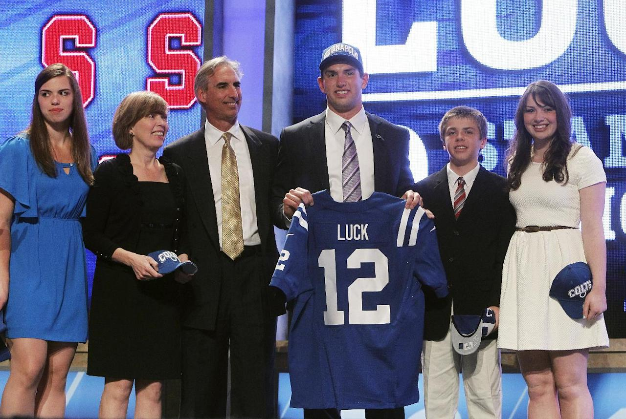 Stanford quarterback Andrew Luck, center, poses for photographs with family after he was selected as the first pick overall by the Indianapolis Colts in the first round of the NFL football draft at Radio City Music Hall, Thursday, April 26, 2012, in New York. (AP Photo/Jason DeCrow)