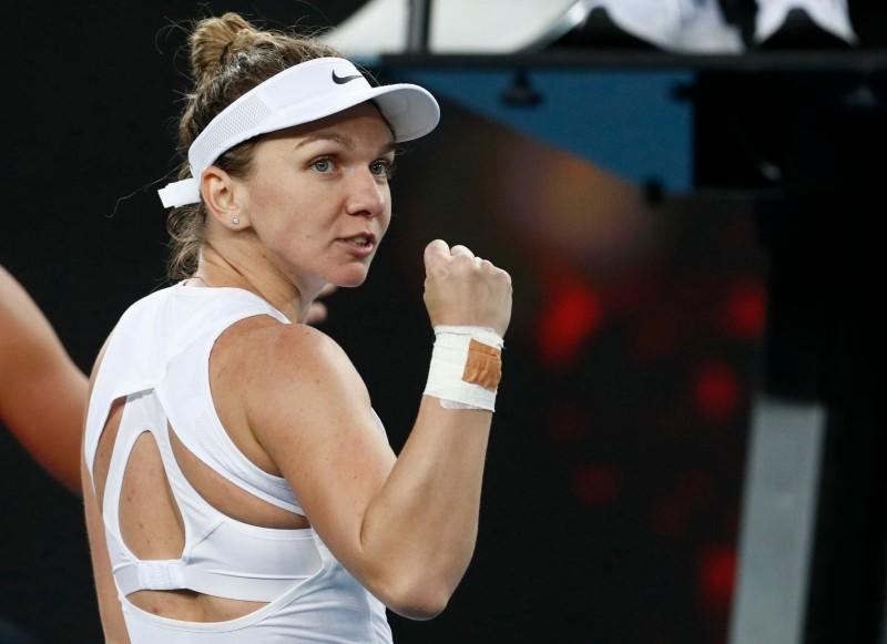Halep survives injury scare in tough first-round win in Melbourne