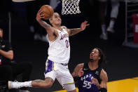 Los Angeles Lakers forward Kyle Kuzma, left, shoots as Toronto Raptors forward Freddie Gillespie defends during the first half of an NBA basketball game Sunday, May 2, 2021, in Los Angeles. (AP Photo/Mark J. Terrill)