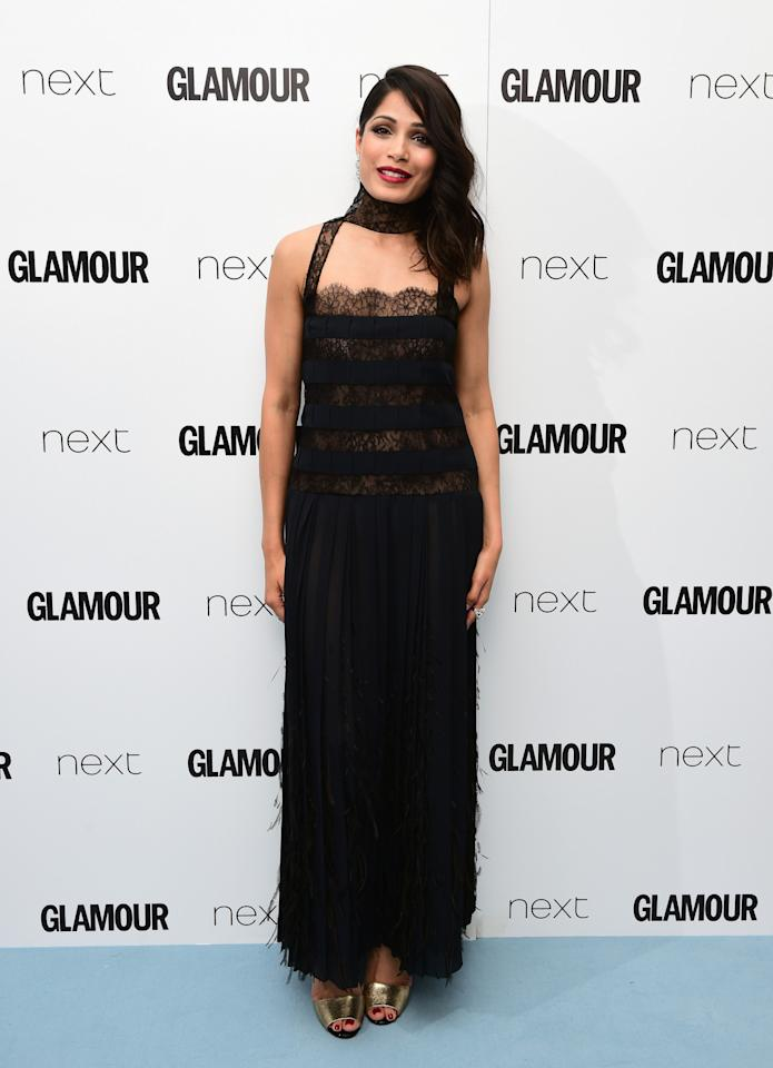 "<p>The ""Slumdog Millionaire"" starlet also opted for a black number, but chose a tiered lace version complete with collar. <i>[Photo: PA Images]</i></p>"