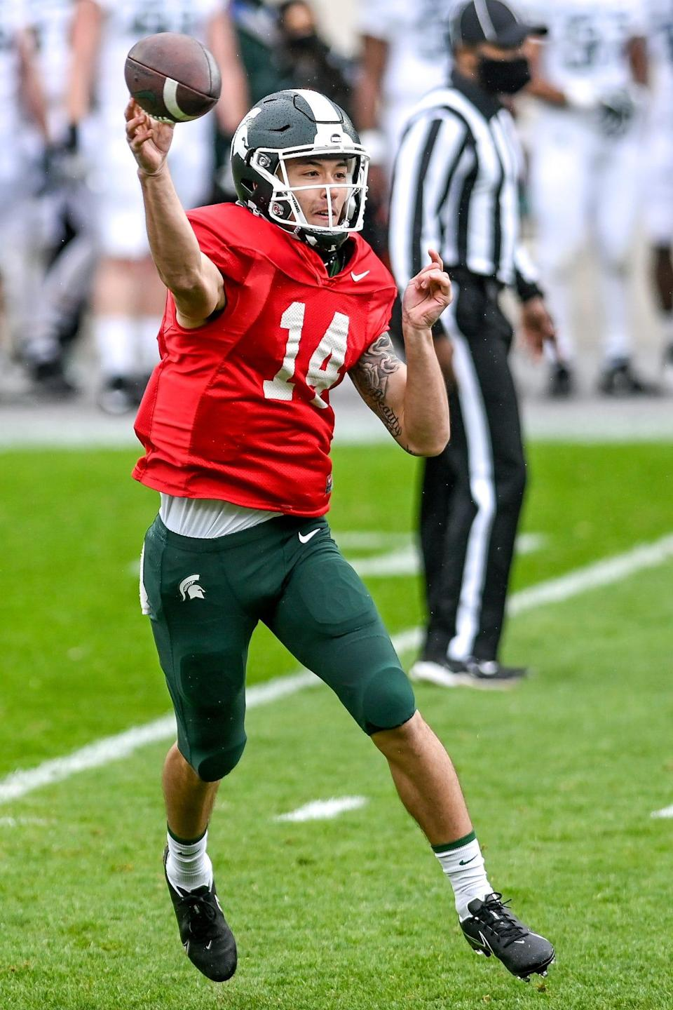 Michigan State's Noah Kim throws a pass during the spring football game on Saturday, April 24, 2021, at Spartan Stadium in East Lansing.