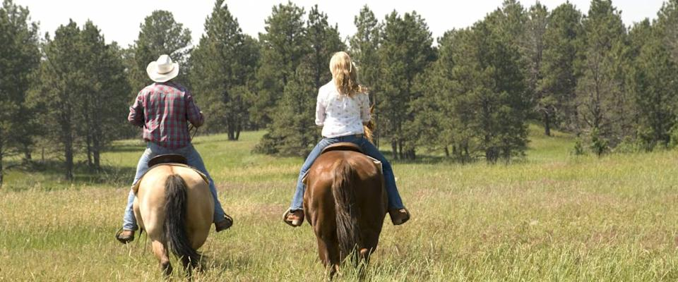 Two People Riding on Wyoming Landscape.