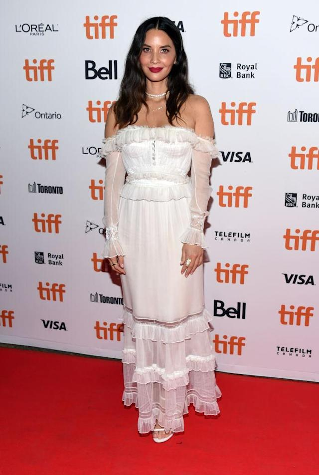 <p>Yes, actress Olivia Munn has made a second appearance on this month's best dressed list thanks to the cold-shoulder dress she chose for the Toronto Film Festival. <em>[Photo: Getty]</em> </p>