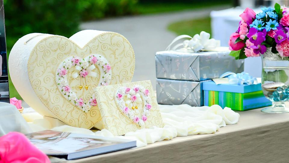 Sweet gift box heart shape on table for wedding day.