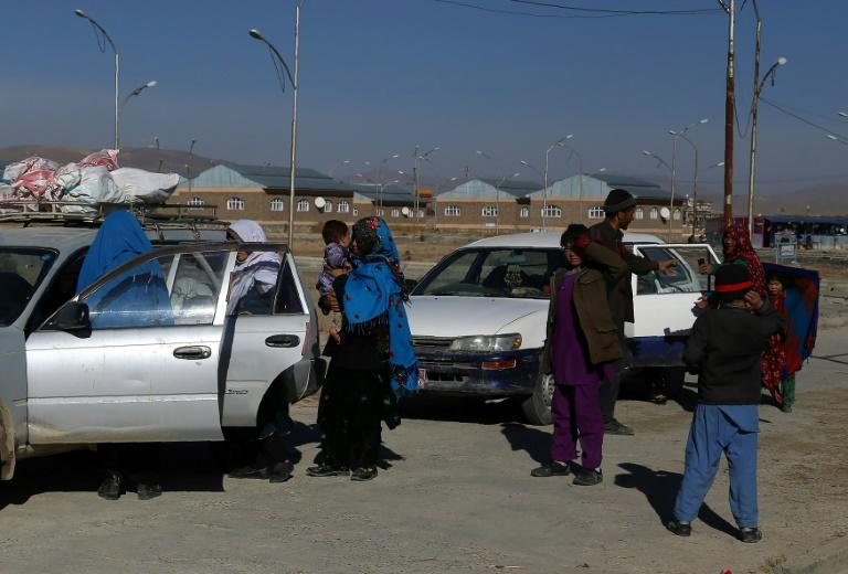 Hundreds have been displaced by intense fighting as the Taliban battle ethnic Hazara militia and government security forces