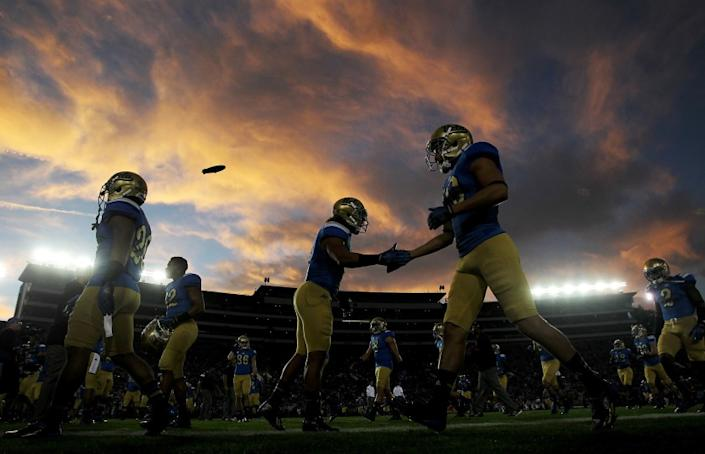 UCLA players warm up before the start of a game against crosstown rival USC on Saturday at the Rose Bowl.