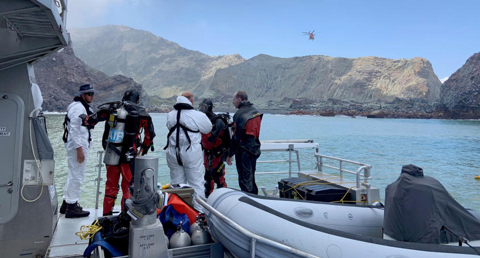 Police divers prepare to search the waters near White Island off the coast of Whakatane, New Zealand.