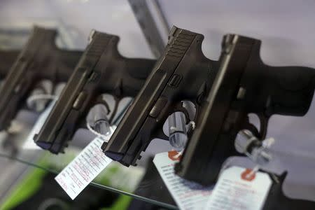 Handguns are seen for sale in a display case at Metro Shooting Supplies in Bridgeton