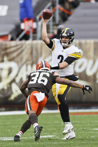 Cleveland Browns cornerback M.J.Stewart Jr. (36) rushes Pittsburgh Steelers quarterback Mason Rudolph (2) during the first half of an NFL football game, Sunday, Jan. 3, 2021, in Cleveland. (AP Photo/Ron Schwane)