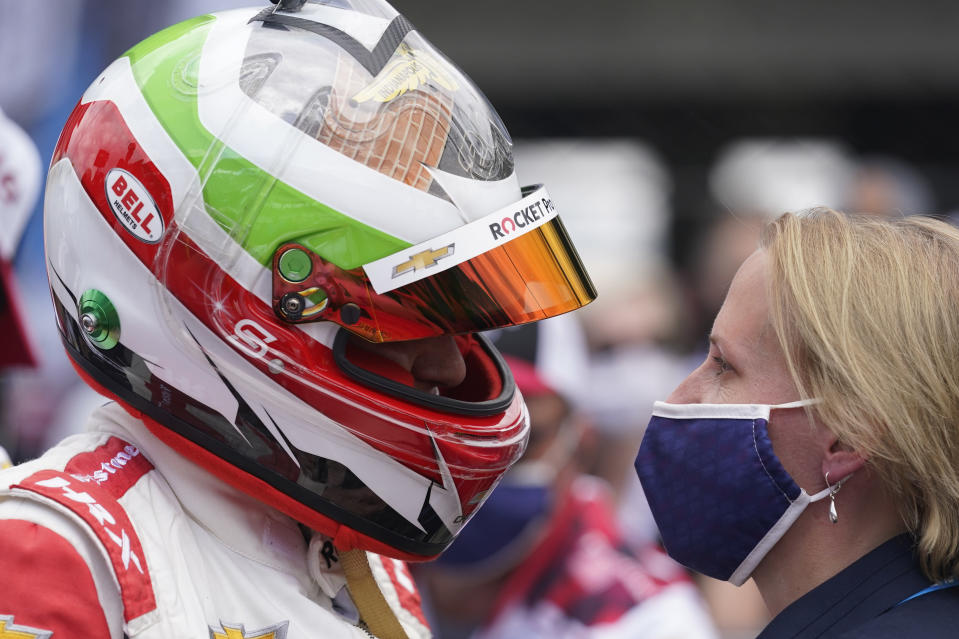 Simona De Silvestro, left, of Switzerland, talks with Beth Paretta after qualifying for the Indianapolis 500 auto race at Indianapolis Motor Speedway, Sunday, May 23, 2021, in Indianapolis. (AP Photo/Darron Cummings)