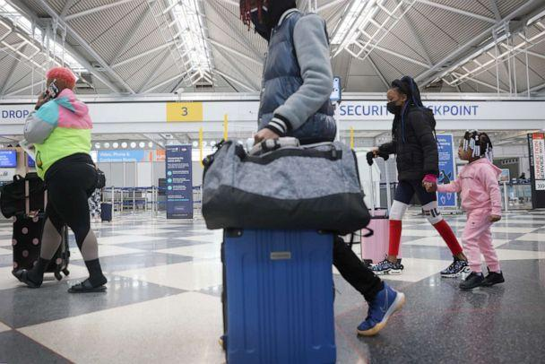 PHOTO: Travelers arrive for flights at O'Hare international Airport on March 16, 2021, in Chicago. (Scott Olson/Getty Images)