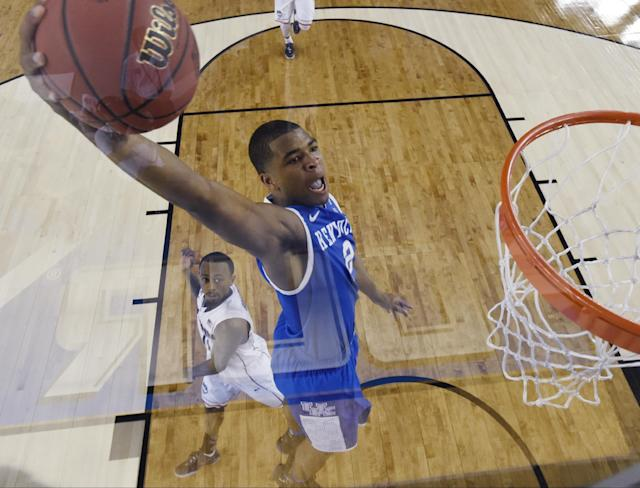 Kentucky guard Aaron Harrison drives to the basket past Connecticut guard Ryan Boatright, rear, during the first half of the NCAA Final Four tournament college basketball championship game Monday, April 7, 2014, in Arlington, Texas. (AP Photo/Chris Steppig, pool)