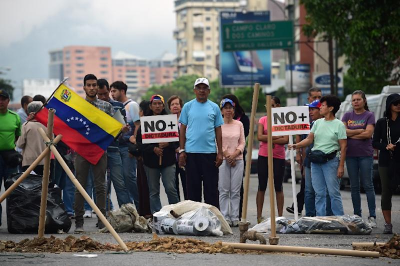 Anti-government protesters block streets in Venezuela