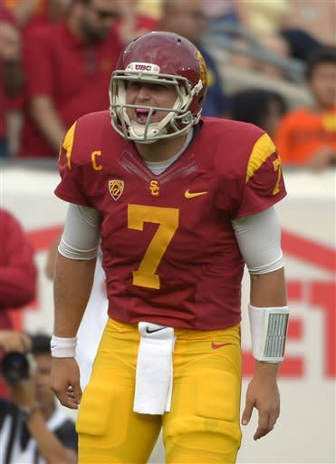 Southern California quarterback Matt Barkley reacts after throwing a touchdown pass during the first half of an NCAA college football game against Colorado, Saturday, Oct.20, 2012, in Los Angeles. (AP Photo/Mark J. Terrill)