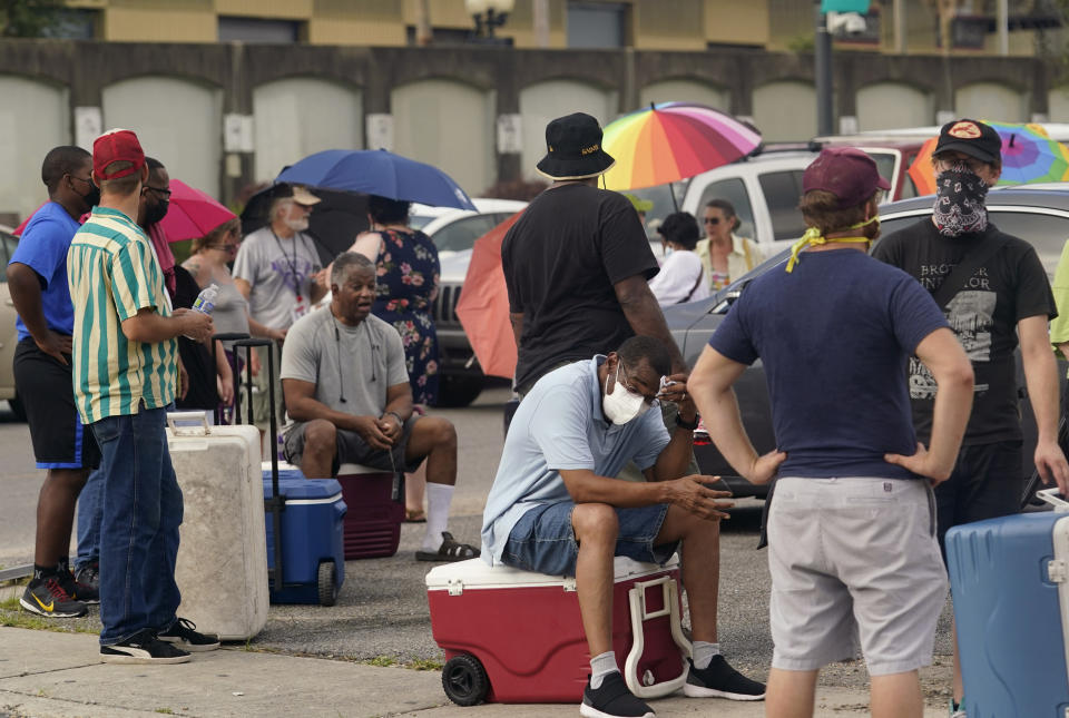 Louisiana residents still reeling from flooding and damage caused by Hurricane Ida are scrambling for food, gas, water and relief from the oppressive heat, Wednesday, Sept. 1, 2021, in New Orleans, La. (AP Photo/Eric Gay)