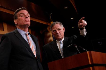Senate Intelligence Committee Chairman Sen. Richard Burr, accompanied by Senator Mark Warner, vice chairman of the committee, speaks at a news conference to discuss their probe of Russian interference in the 2016 election on Capitol Hill in Washington