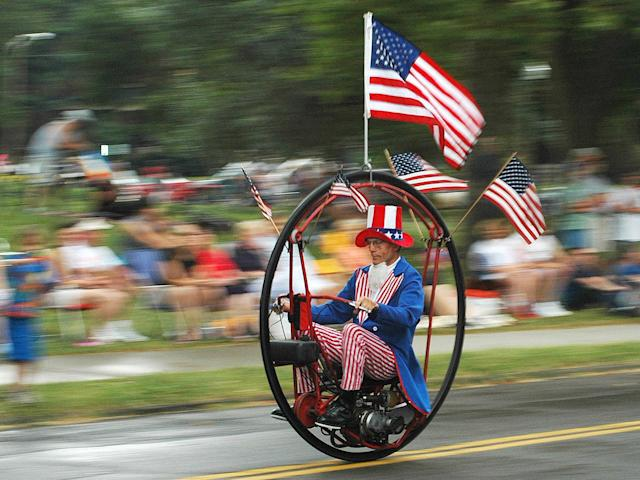 <p>Hoop-mobile rider Keith Dufrane dons patriotic clothing during the DooDah Parade in Columbus, Ohio, Sunday, July 4, 2004. (Photo: Columbus Dispatch, Mike Elicson/AP) </p>