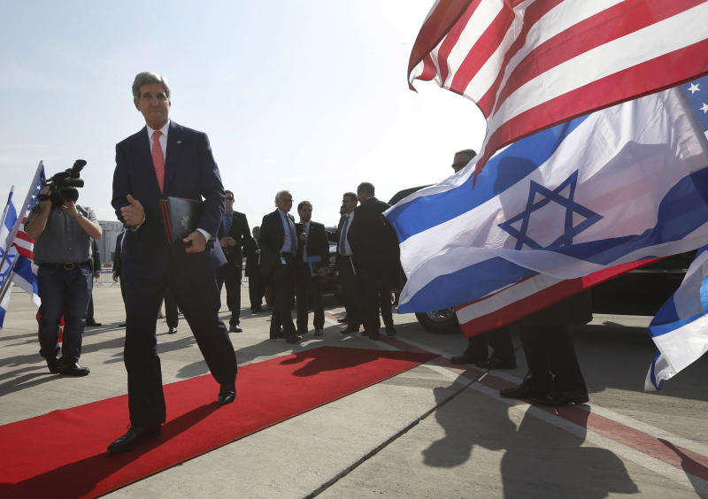 """U.S. Secretary of State John Kerry walks to his plane after meeting with Israeli Prime Minister Benjamin Netanyahu in Tel Aviv, Israel, Friday, Nov. 8, 2013. Netanyahu, before meeting with Kerry, said Friday that he """"utterly rejects"""" the emerging nuclear deal between western powers and Iran, calling it a """"bad deal"""" and promising that Israel will do everything it needs to do to defend itself. (AP Photo/Jason Reed, Pool)"""
