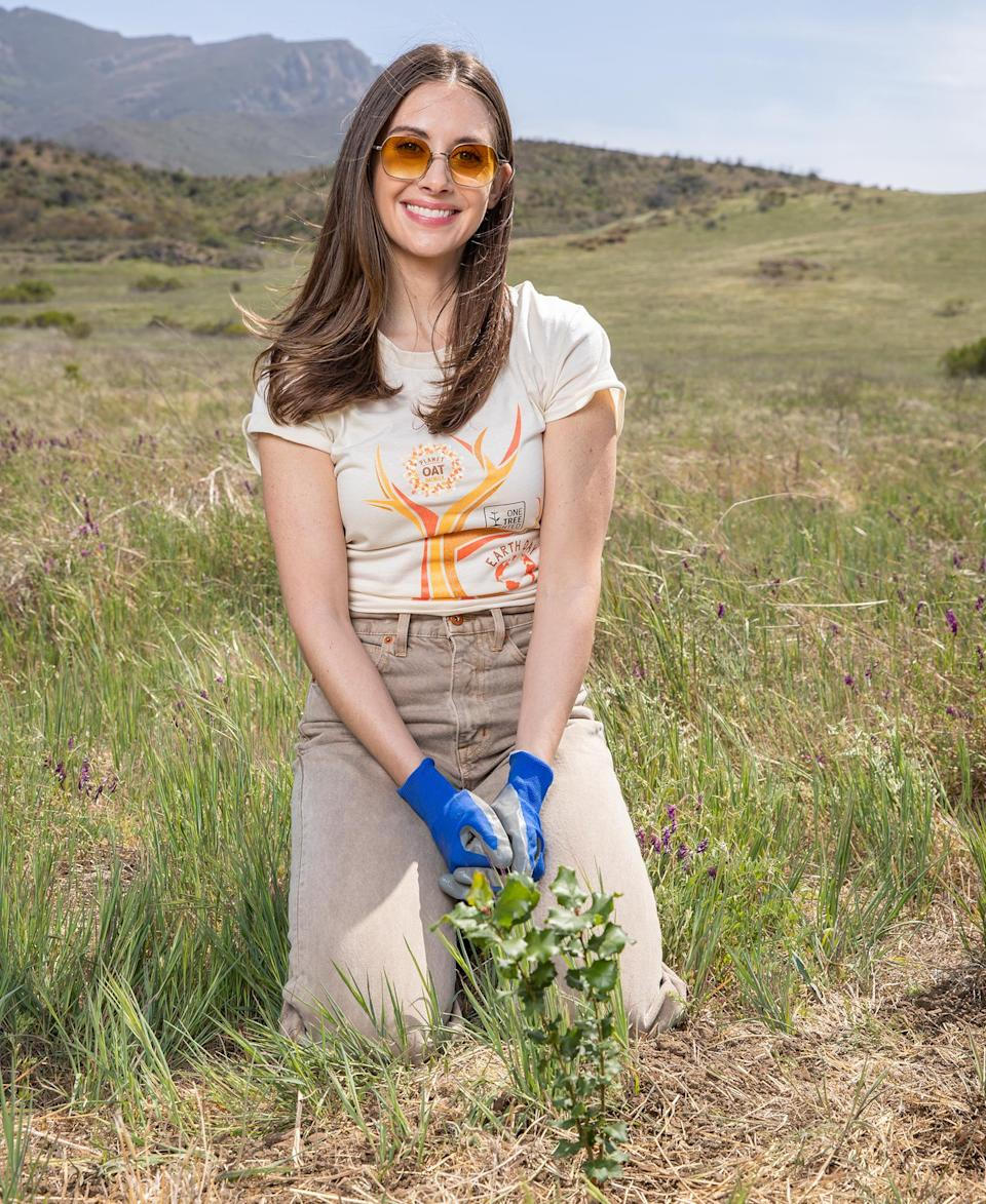 <p>Alison Brie plants a tree as part of the Planet Oat Project to support reforestation in honor of Earth Day in Malibu.</p>