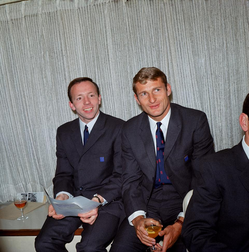 (L-R) England's Nobby Stiles and Roger Hunt, wearing their official England World Cup suits (Photo by PA Images via Getty Images)