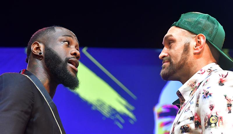 Boxers Deontay Wilder (L) and Tyson Fury (R) face-off during a press conference in Los Angeles, California on January 13, 2020 ahead of their re-match fight in Las Vegas on February 22. (Photo by Frederic J. BROWN / AFP) (Photo by FREDERIC J. BROWN/AFP via Getty Images)