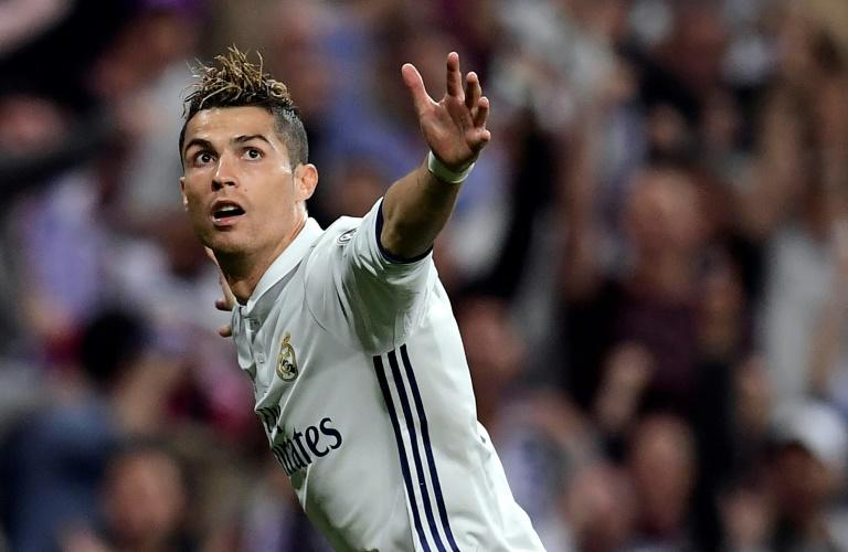 Real Madrid's Cristiano Ronaldo celebrates after scoring against Atletico Madrid during their Champions League match at the Santiago Bernabeu stadium on May 2, 2017