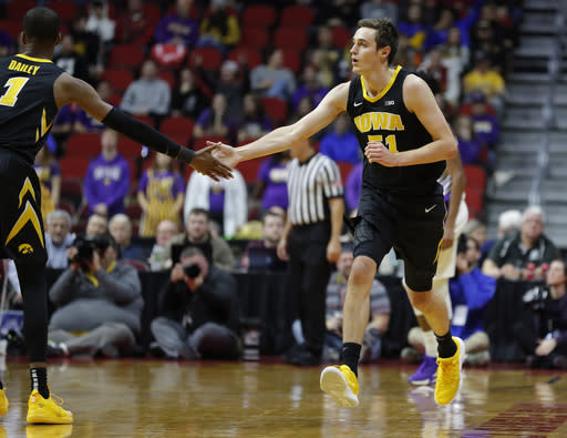 Iowa forward Nicholas Baer, right, high fives Iowa guard Maishe Dailey, left, after a Baer scored a 3-pointer against Northern Iowa during the first half of an NCAA college basketball game, Saturday, Dec. 15, 2018, in Des Moines, Iowa. (AP Photo/Matthew Putney)