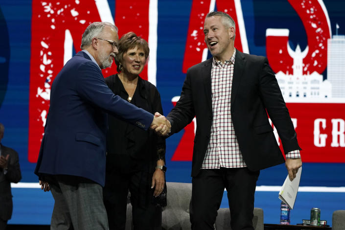 Outgoing Southern Baptist Convention President J. D. Greear, right, greets incoming President Ed Litton, left, and his wife, Kathy Litton, at the conclusion of the annual Southern Baptist Convention meeting Wednesday, June 16, 2021, in Nashville, Tenn. (AP Photo/Mark Humphrey)