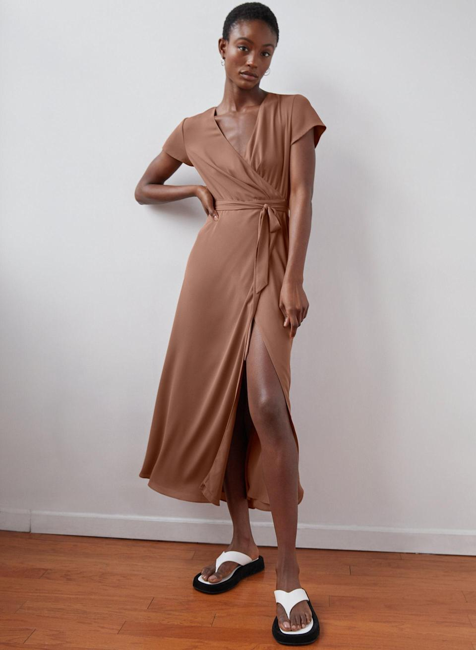 """This classic slit wrap dress comes in three neutral colors—so you'll find a match for any bridal party. $128, Aritzia. <a href=""""https://www.aritzia.com/us/en/product/slit-wrap-dress/70955.html?dwvar_70955_color=3657"""" rel=""""nofollow noopener"""" target=""""_blank"""" data-ylk=""""slk:Get it now!"""" class=""""link rapid-noclick-resp"""">Get it now!</a>"""