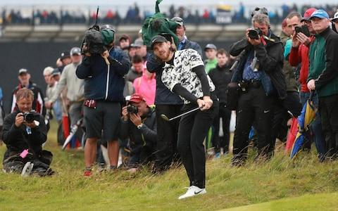 <span>Fleetwood makes birdie on the 12th to cut Lowry's lead to four shots</span> <span>Credit: REUTERS/Ian Walton </span>