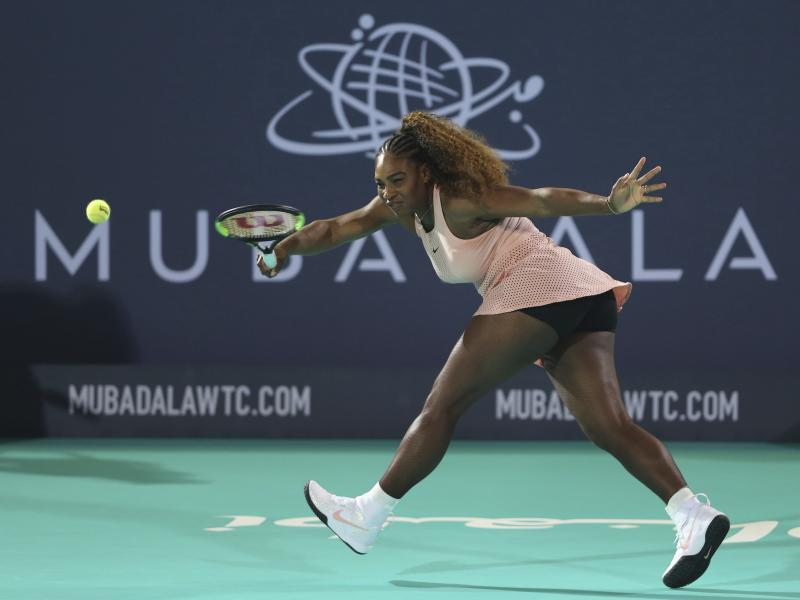 Serena Williams returns the ball to her sister Venus during a match at the opening day of the Mubadala World Tennis Championship in Abu Dhabi, United Arab Emirates on Dec. 27. (ASSOCIATED PRESS)
