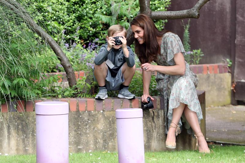 KINGSTON, ENGLAND - JUNE 25: Catherine, Duchess of Cambridge speaks with Josh Evans at photography workshop for Action for Children, run by the Royal Photographic Society at Warren Park on June 25, 2019 in Kingston, England. (Photo by Chris Jackson/Getty Images)
