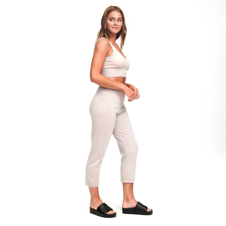 "<h2>Nadaam Cropped Cashmere Pants</h2><br>After Nadaam co-founder <a href=""https://www.barrons.com/articles/good-company-naadams-cashmere-knitwear-makes-sustainable-fashion-accessible-01582234589"" rel=""nofollow noopener"" target=""_blank"" data-ylk=""slk:Matt Scanlan spent a month living with a family of Mongolian goat herders"" class=""link rapid-noclick-resp"">Matt Scanlan spent a month living with a family of Mongolian goat herders</a> in 2013, he launched a direct-to-consumer brand that purchases fiber directly from the nomadic herdspeople who raise and shear the <a href=""https://naadam.co/pages/facts-about-cashmere"" rel=""nofollow noopener"" target=""_blank"" data-ylk=""slk:cashmere-producing Zalaa Jinst goat"" class=""link rapid-noclick-resp"">cashmere-producing Zalaa Jinst goat</a>, enabling them to earn more income. In addition, through the Gobi Revival Fund, Nadaam supports 1,000 nomadic herding families and has provided veterinary care to over 250,000 goats. The BEST part? This give-back brand has got best-selling joggers and sweatpants aplenty! We gravitated towards this chic cropped style — perfect for pairing with slip-on sneakers on a milder day.<br><br><strong>Nadaam</strong> Cashmere Cropped Pant, $, available at <a href=""https://go.skimresources.com/?id=30283X879131&url=https%3A%2F%2Fnaadam.co%2Fcollections%2Fwomens-bottoms%2Fproducts%2Fcashmere-cropped-pant%3Fvariant%3D32616968355936"" rel=""nofollow noopener"" target=""_blank"" data-ylk=""slk:Nadaam"" class=""link rapid-noclick-resp"">Nadaam</a>"