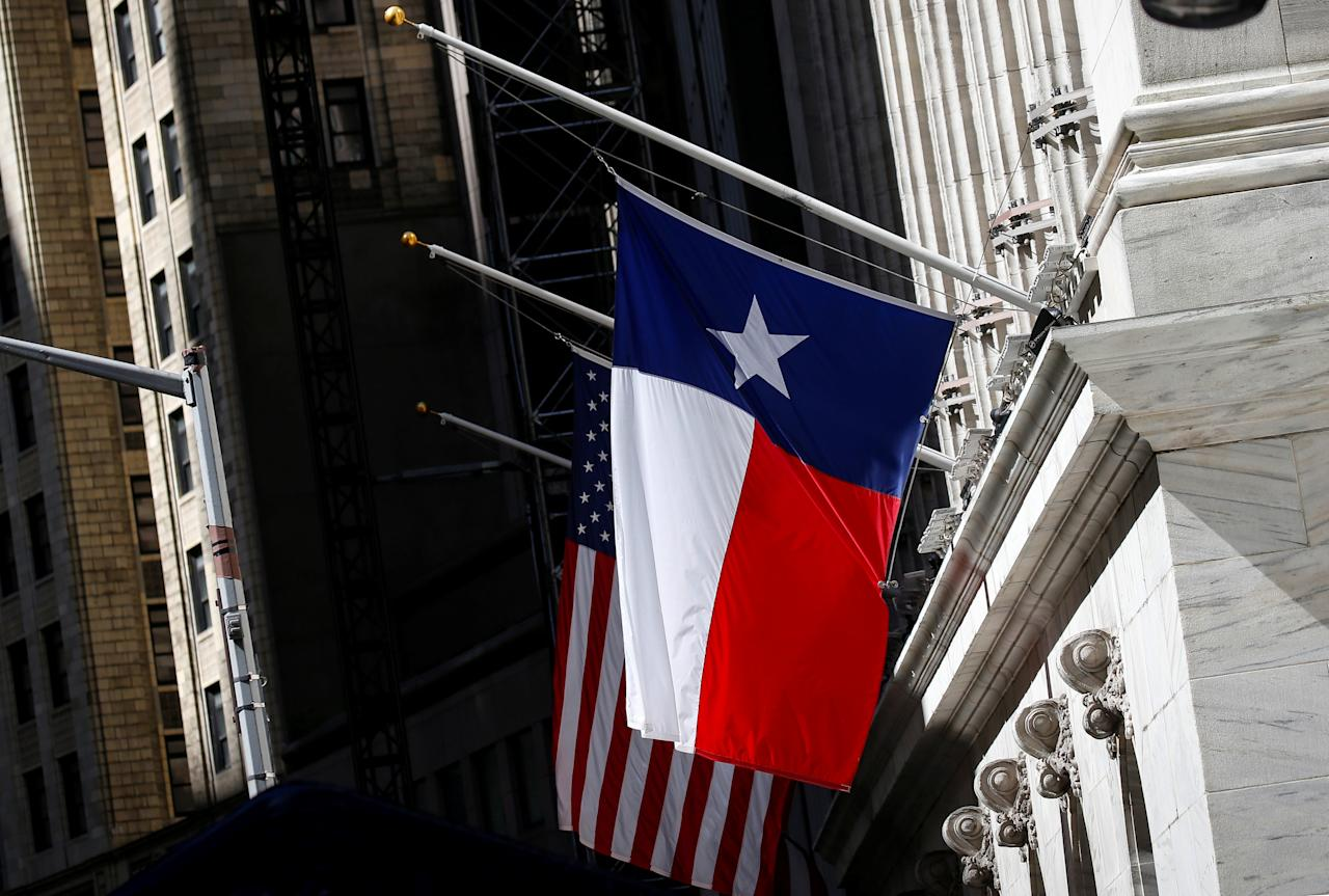 The Texas state flag flag flys at half mast outside the New York Stock Exchange (NYSE) in New York, U.S., May 21, 2018. REUTERS/Brendan McDermid