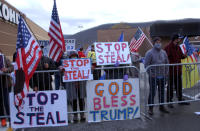 Approximately 100 Trump supporters some with flags and signs stood across West Third Street from the Federal Building in Williamsport, Pa., for hours Tuesday, Nov. 17, 2020, chanting such things as 'Four More Years,' 'Black Lives Matter,' 'We Want Trump' and 'Dead People Can't Vote.' Attorneys for the Trump campaign organization inside the Federal Building were arguing why the state and seven county election boards were arguing should not certify the results of the general election because voters across the state were not treated the same. (John Beauge/The Patriot-News via AP)