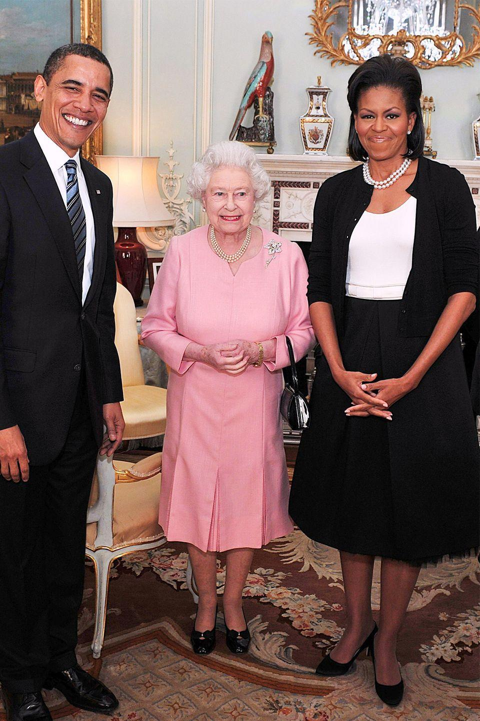 """<p>Touching members of the royal family is a big no-no, <em>especially</em> when it comes to Her Majesty. But when the matriarch met former First Lady Michelle Obama, Elizabeth appeared to fan girl just as hard as anyone would. The Queen uncharacteristically slung her arm around Obama during their photo op (which you can see for yourself, <a href=""""https://www.youtube.com/watch?v=eU_0hyjXRaM"""" rel=""""nofollow noopener"""" target=""""_blank"""" data-ylk=""""slk:here"""" class=""""link rapid-noclick-resp"""">here</a>).</p>"""