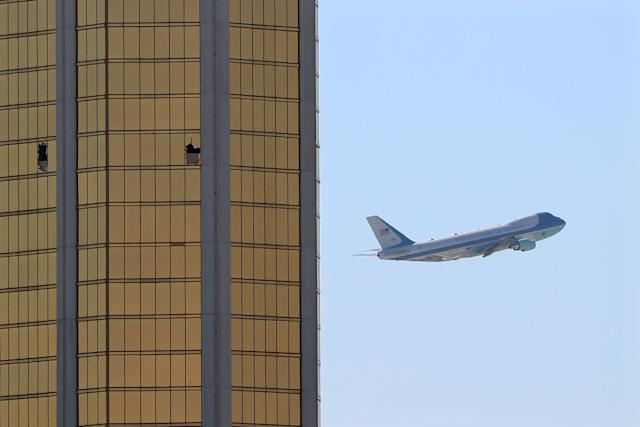Air Force One departs Las Vegas past the broken windows on the Mandalay Bay hotel, where shooter Stephen Paddock conducted his mass shooting along the Las Vegas Strip in Las Vegas, Nevada, U.S., October 4, 2017.