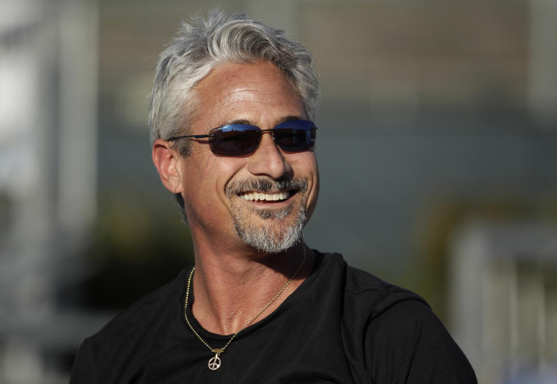 In a Feb. 1, 2011 photo, former Olympic gold medalist and diving coach Greg Louganis smiles while training young divers from SoCal Divers at Fullerton College in Fullerton, Calif.     It will be 23 years this summer since Greg Louganis won the last of the four Olympic gold medals he accumulated during a run through the 1980s that established him as the greatest platform and springboard diver the world had ever seen.  Louganis is back, doing what he says he always wanted to do after his diving days ended, coach aspiring young divers.  (AP Photo/Jae C. Hong)
