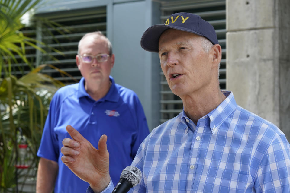Senator Rick Scott, R-Fla., right, speaks during a news conference after having toured the National Hurricane Center with director Ken Graham, left, Tuesday, June 1, 2021, at the center in Miami. Tuesday marks the start of the 2021 Atlantic hurricane season which runs to Nov. 30. (AP Photo/Wilfredo Lee)