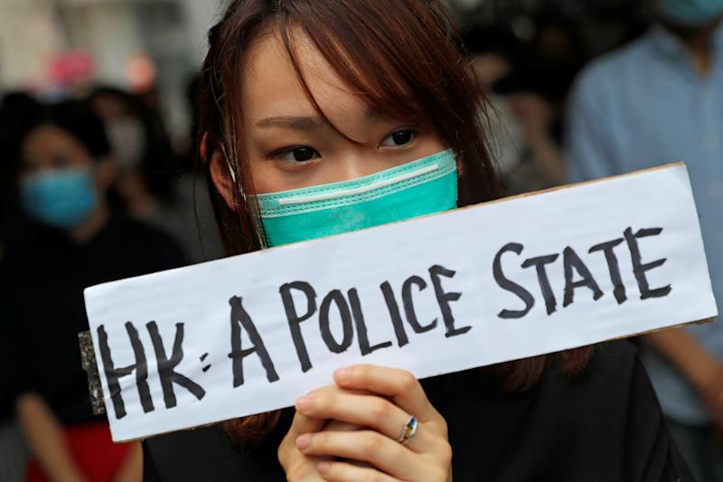 People attend a gathering to protest against what they say is the abuse of pro-democracy protesters by Hong Kong police, at Chater Garden in Central district, Hong Kong, China October 11, 2019. REUTERS/Susana Vera
