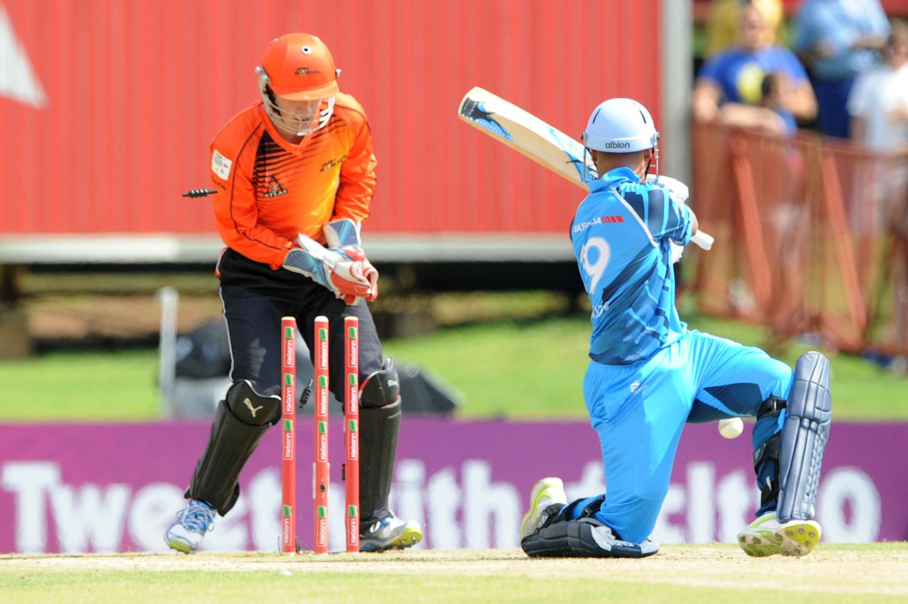 PRETORIA, SOUTH AFRCA - OCTOBER 13:  Henry Davids of the Titans is bowled by Michael Beer (not pictured) during the Karbonn Smart CLT20 match between Nashua Titans (South Africa) and Perth Scorchers (Australia) at SuperSport Park on October 13, 2012 in Pretoria, South Africa.  (Photo by Lee Warren/Gallo Images/Getty Images)