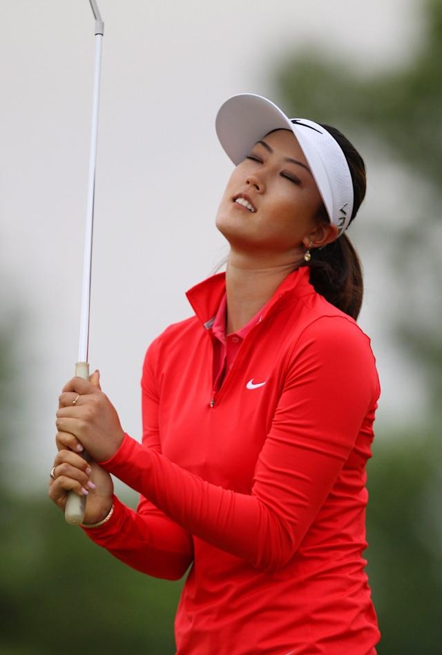 Michelle Wie reacts to a missed birdie putt on the third hole in the final round of the Manulife Financial LPGA Classic golf tournament Sunday, June 8, 2014, in Waterloo, Ontario. (AP Photo/The Canadian Press, Dave Chidley)