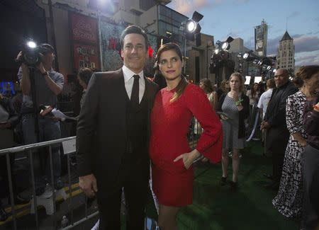 """Cast members Hamm and Bell pose at the premiere of """"Million Dollar Arm"""" at El Capitan theatre in Hollywood"""
