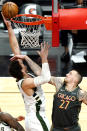 Milwaukee Bucks center Brook Lopez, left, shoots against Chicago Bulls center Daniel Theis during the first half of an NBA basketball game in Chicago, Friday, April 30, 2021. (AP Photo/Nam Y. Huh)