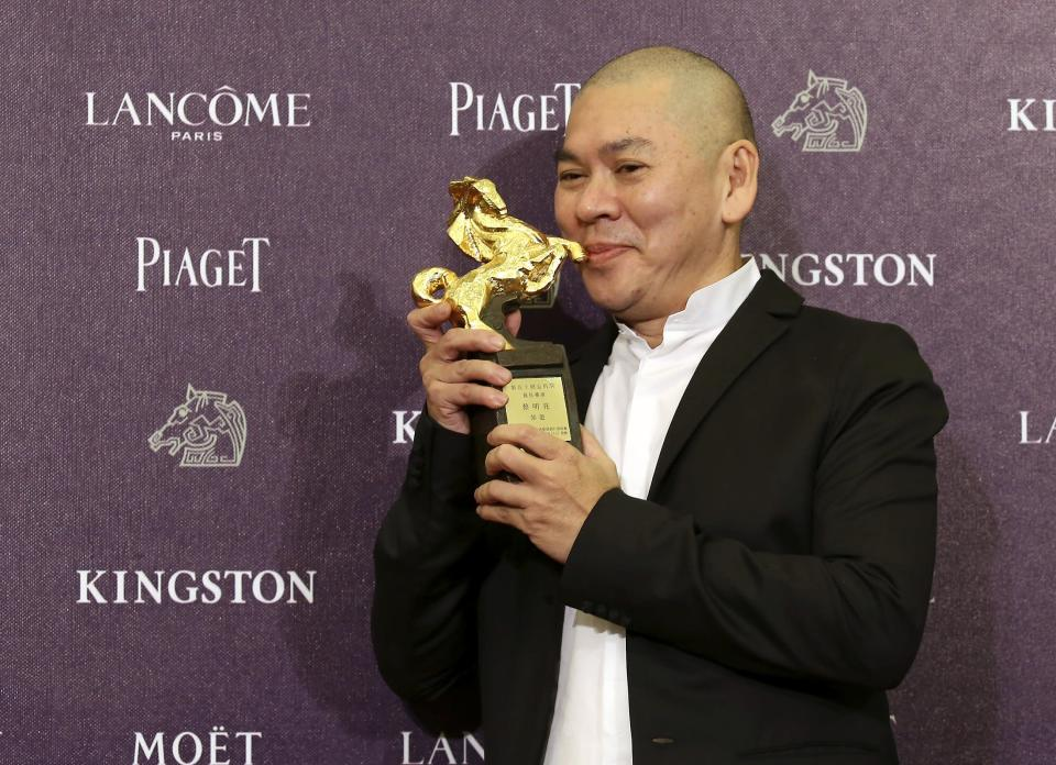 """Taiwanese director Tsai Ming-liang celebrates winning the Best Director for """"Stray Dogs"""" at the 50th Golden Horse Film Awards in Taipei November 23, 2013. REUTERS/Patrick Lin (TAIWAN - Tags: ENTERTAINMENT)"""