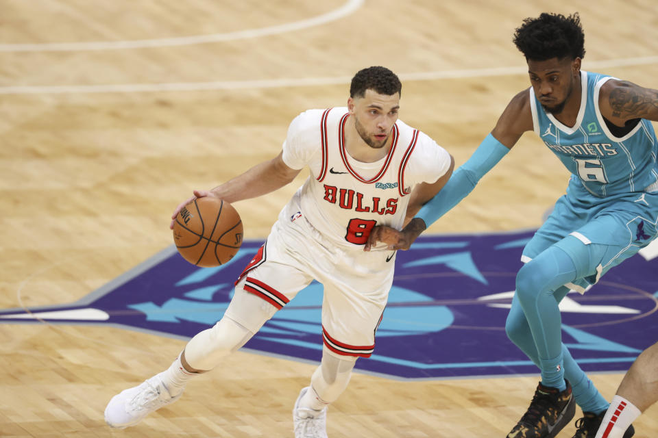 Chicago Bulls guard Zach LaVine, left, drives against Charlotte Hornets forward Jalen McDaniels during the second half of an NBA basketball game in Charlotte, N.C., Thursday, May 6, 2021. (AP Photo/Nell Redmond)