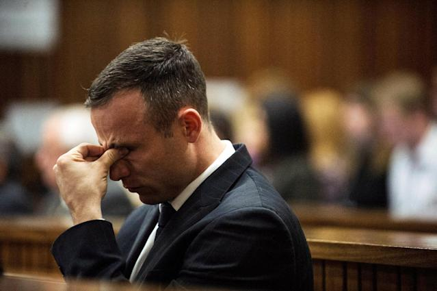 South African Olympic and Paralympic athlete Oscar Pistorius reacts during his murder trial in the North Gauteng High Court in Pretoria, South Africa, April 16, 2014. REUTERS/Gianluigi Guercia/File Photo
